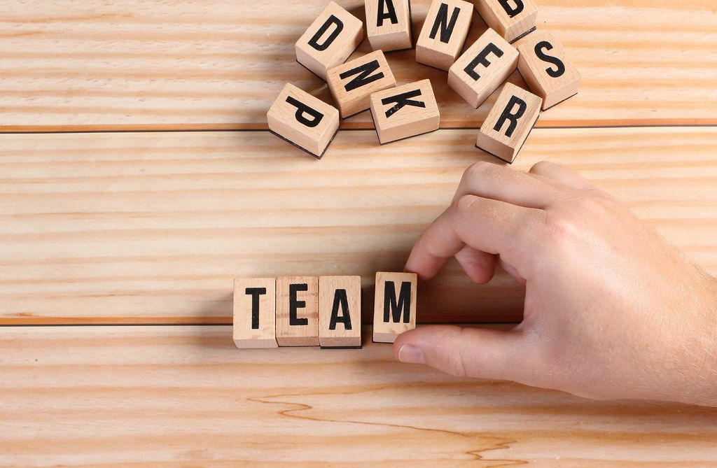Team word written on wooden blocks