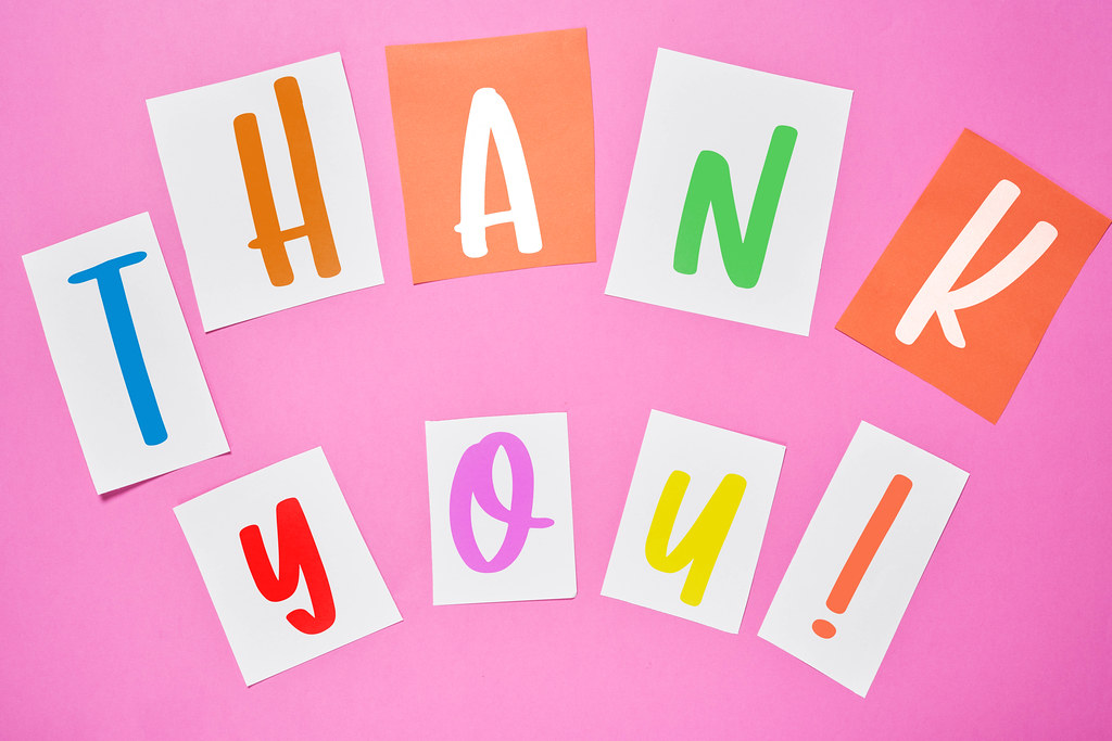 Thank you - cut out newspaper letters on pink background