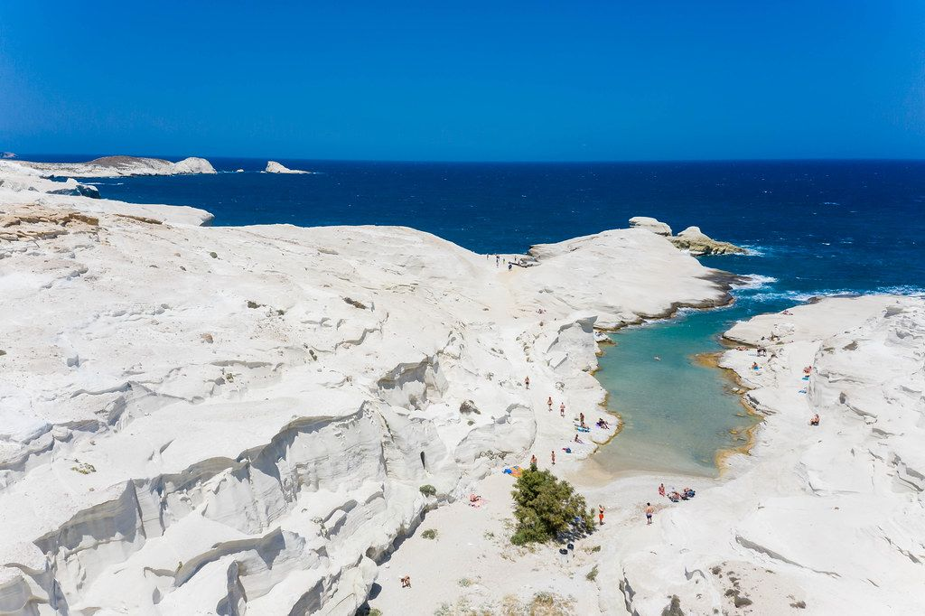 The beautiful white cliffs and turquoise sea of Milos, Greece with very few tourists in summer 2020
