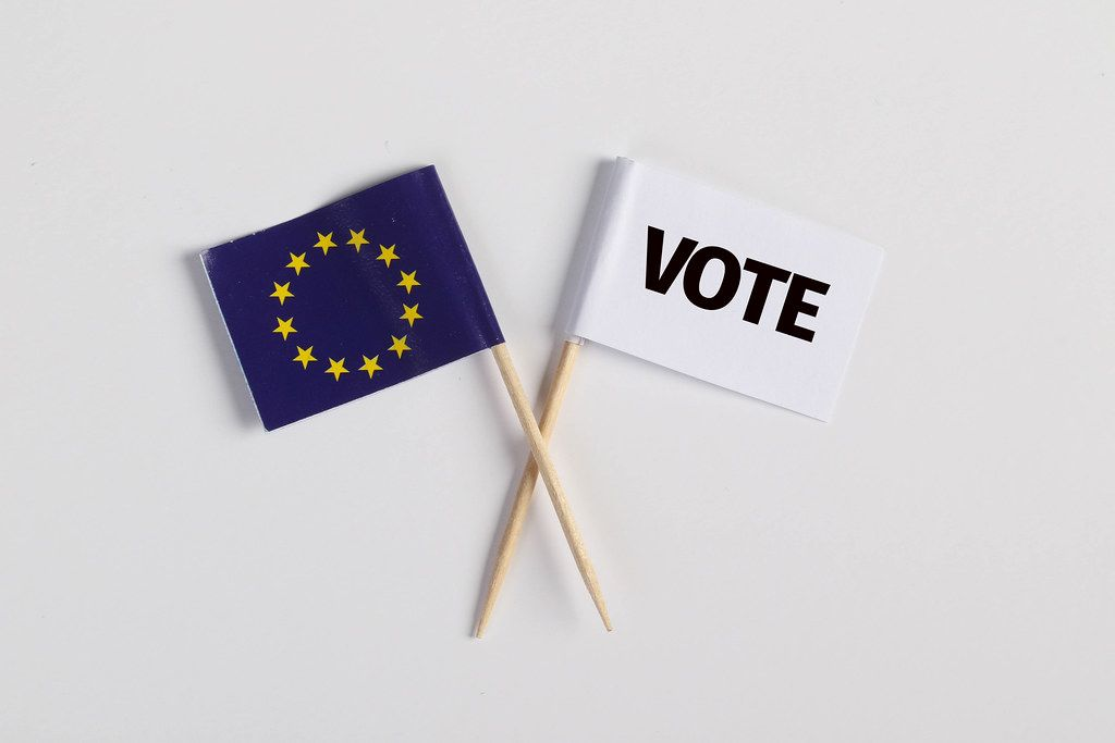 The European flag and white flag with vote text on white background