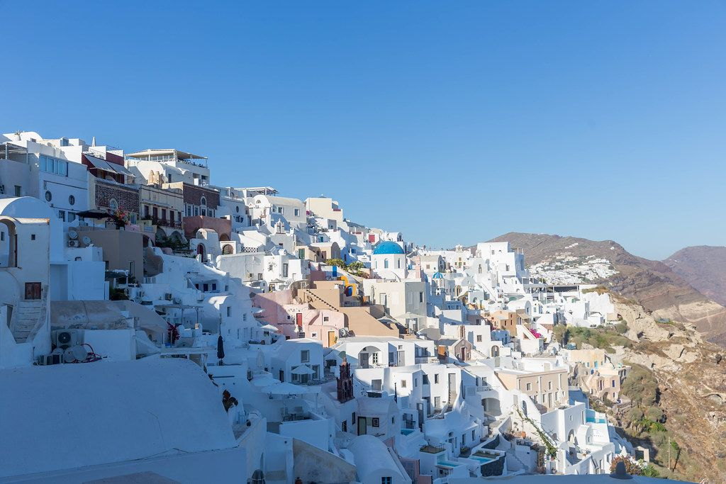 The famous white village of Oia with the blue domes on the Greek island of Santorini