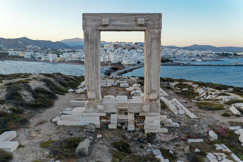 The main town and port of Naxos, Chora or Naxos City, framed by the Portara, symbol of the island