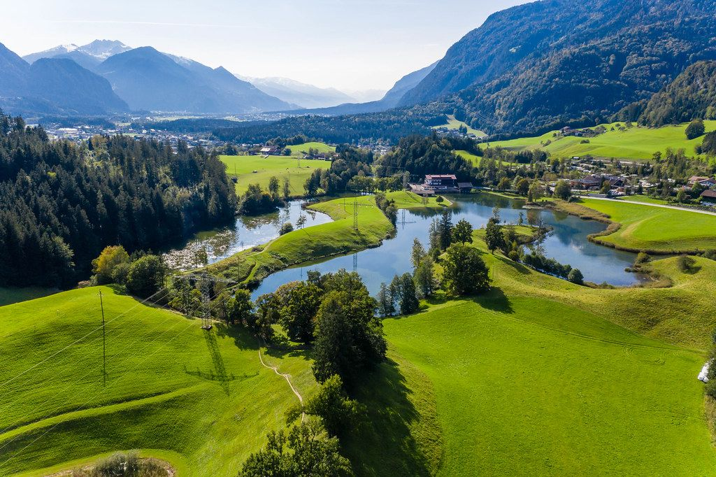 The many lakes surrounding the village of Kramsach in the Brandenberg Alps in Austria. Drone photo