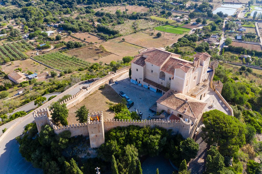 The medieval fortress and sanctuary of Sant Salvador on the Calvary Hill in Artà in a drone photo