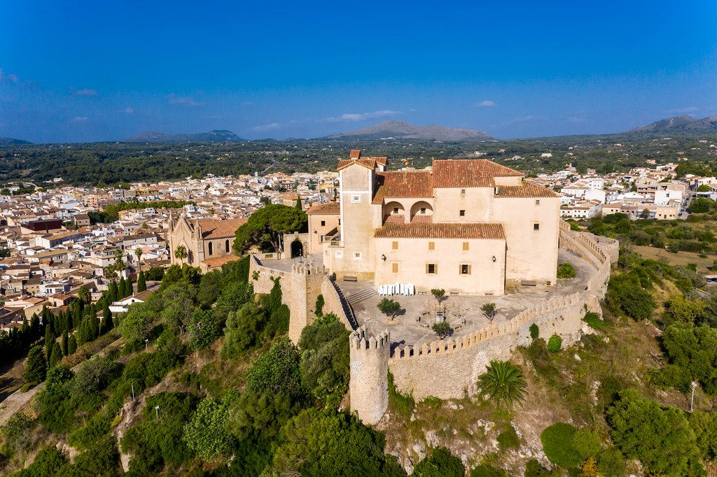 The medieval fortress on the Puig de Sant Salvador hill in Artà. Drone image of Sant Salvador sanctuary