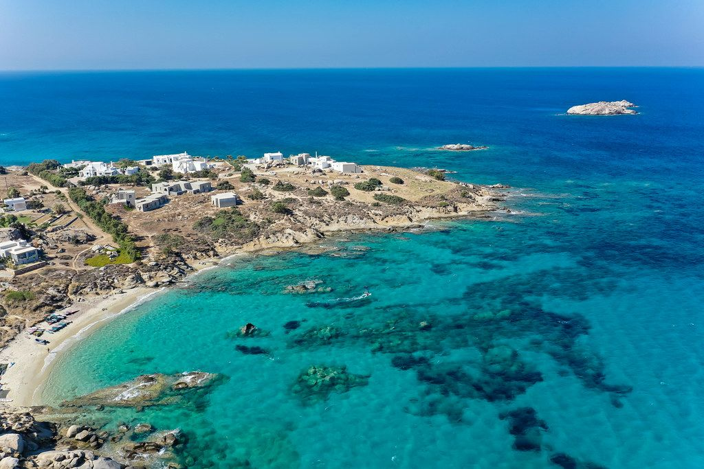 The Mikri Vigla headland with its two north- and south-facing beaches. Drone shot on Naxos, Greece