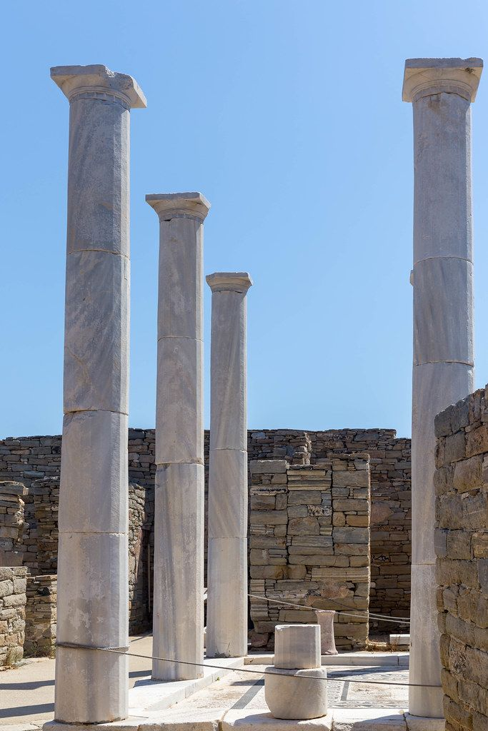 The pillars of the House of Cleopatra, famous for its unique statues, in the theatre quarter of Delos