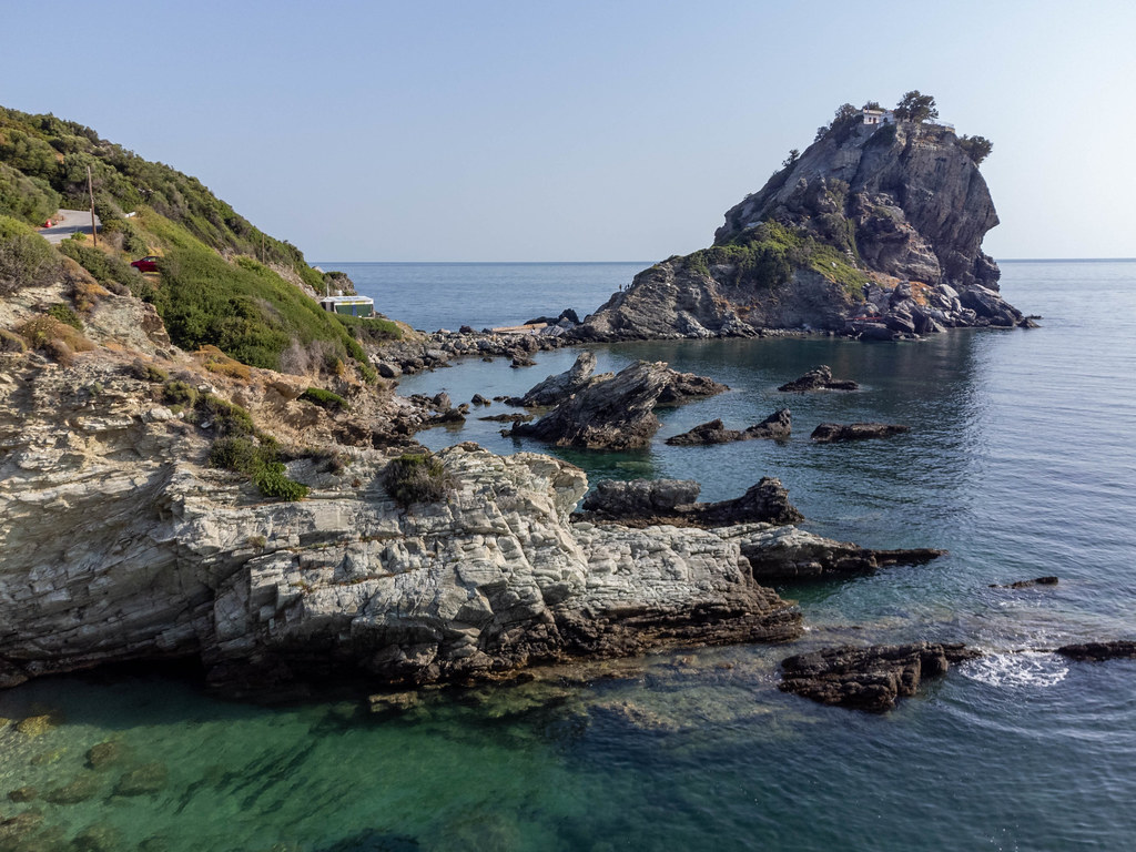 The rocky coast at Agios Ioannis, Skopelos, with the monastery and chapel accessible with 200 steep steps