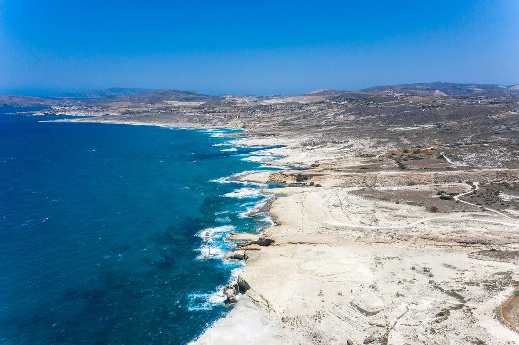 The rough, wild landscape of the north coast of the Greek island of Milos (Cyclades), seen from the air