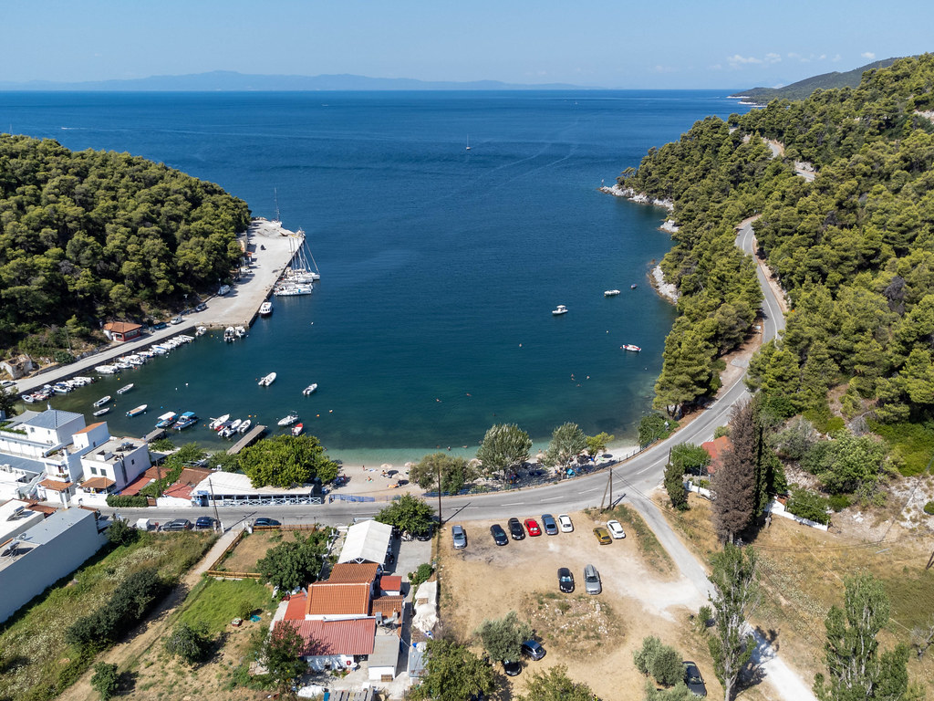 The small beach village of Agnontas on Skopelos with its port. Aerial view