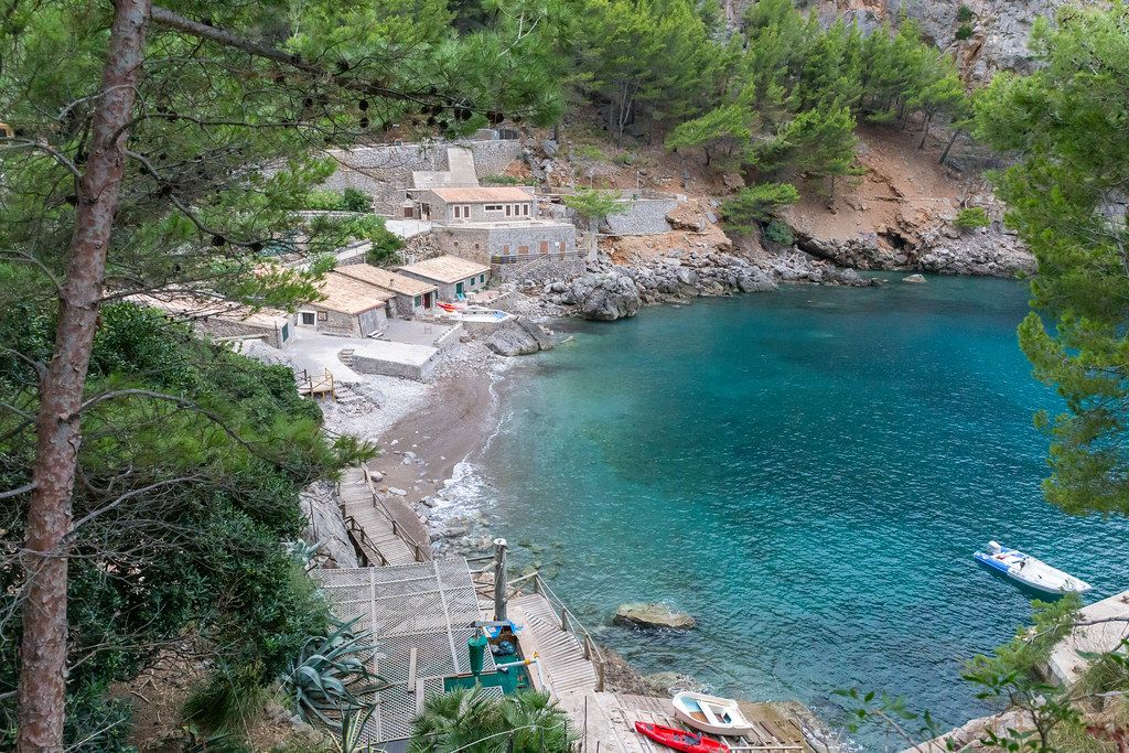 The small harbour and bay at Port de Sa Calobra in the Serra de Tramuntana region in Majorca