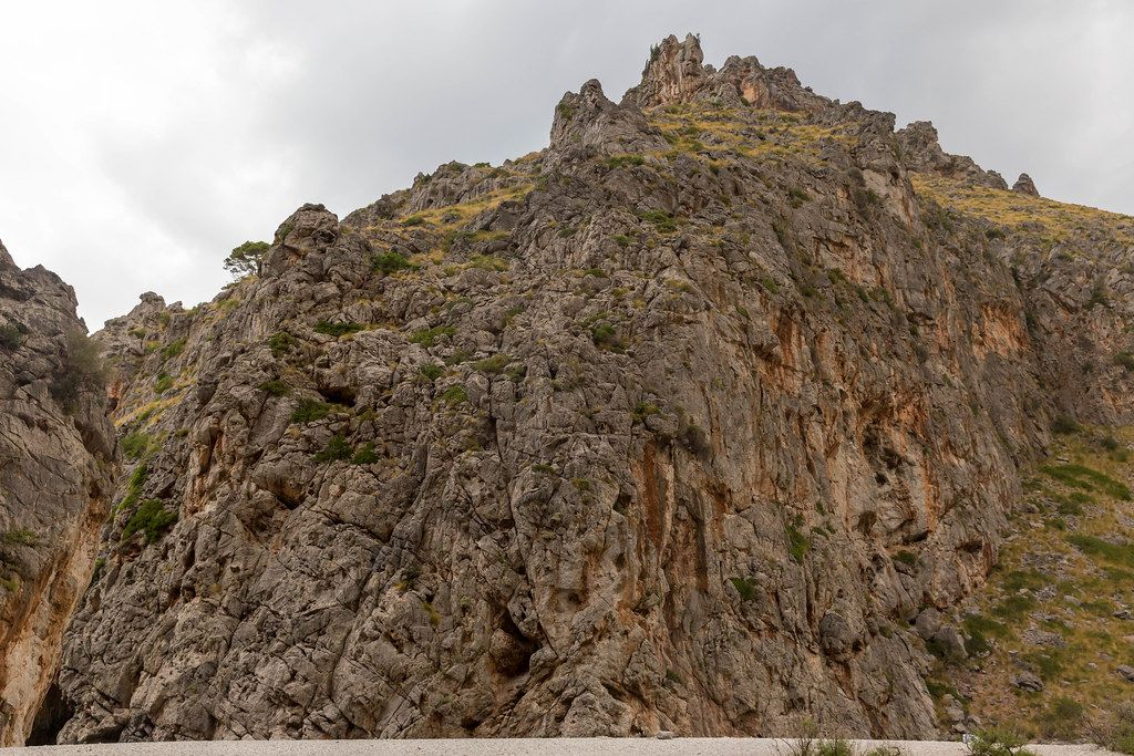 The steep rock walls of the canyon formed by the Torrent de Pareis at Sa Calobra, Mallorca