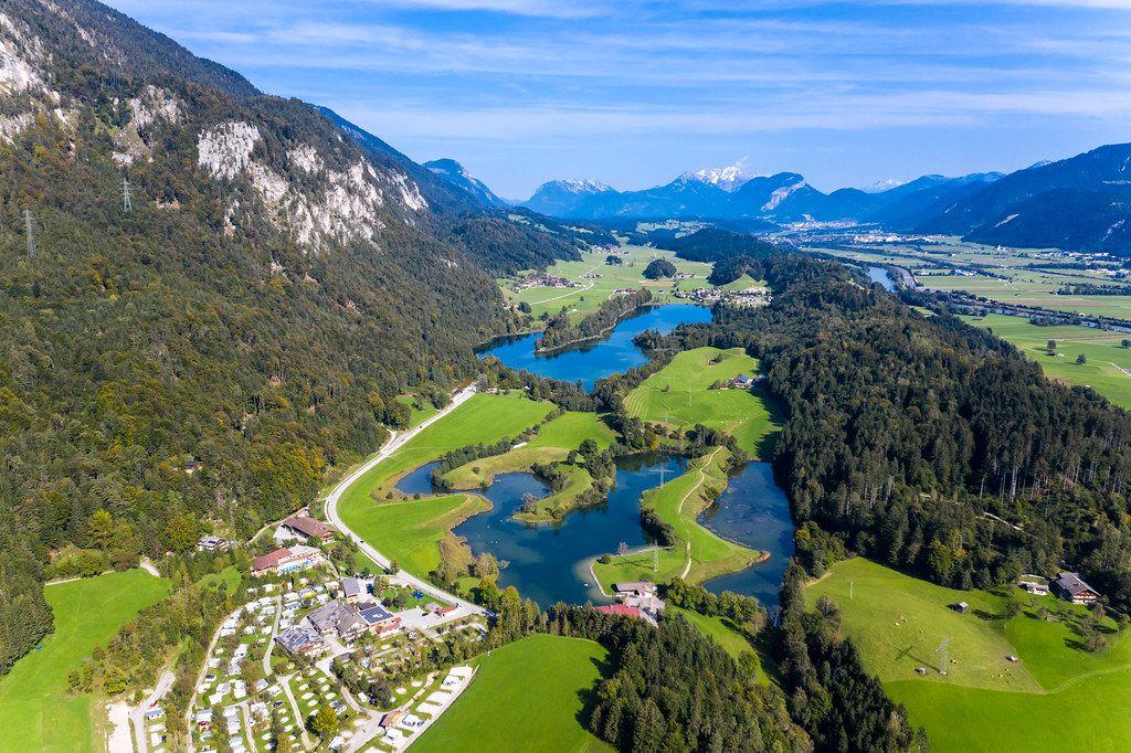 The three swimming lakes near Kramsach in Tyrol, Austria: Lake Reintal, Buchsee, Krummsee. Drone pic
