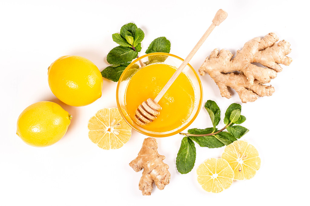 The view from the top, ginger root, mint leaves, lemons and honey on white
