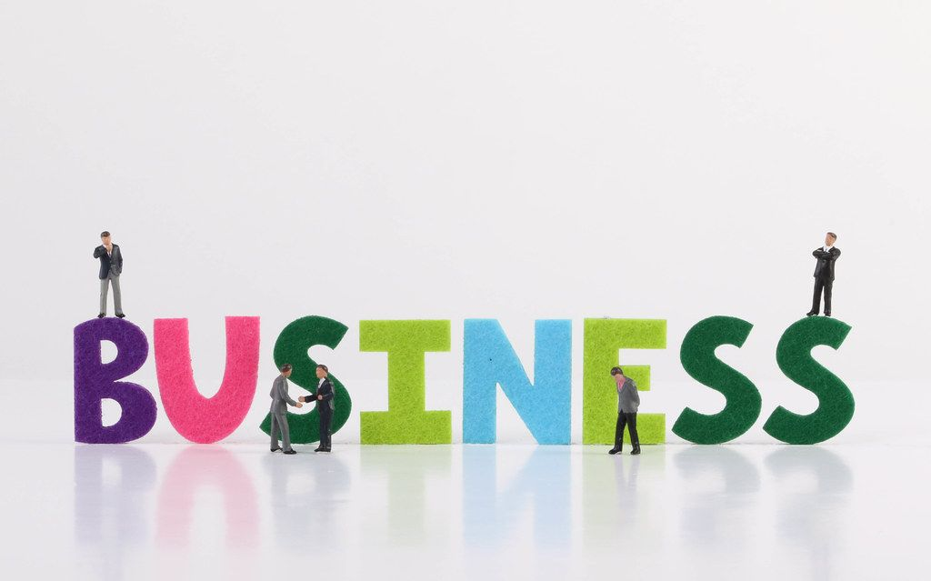 The word Business with group of businessman on white background