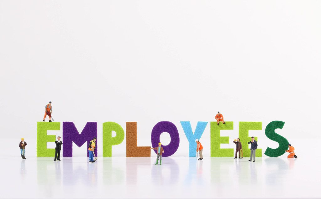 The word Employess with tiny workers on white background