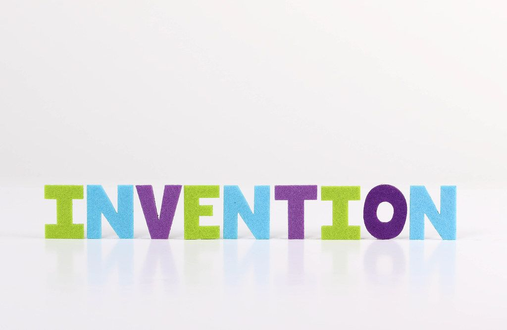The word Invention on white background