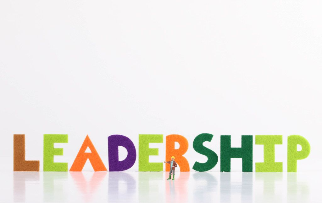 The word Leadership with construction worker on white background