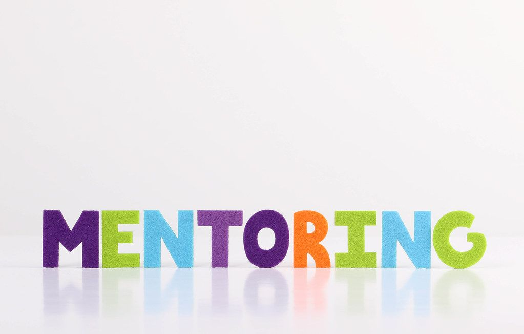 The word Mentoring on white background