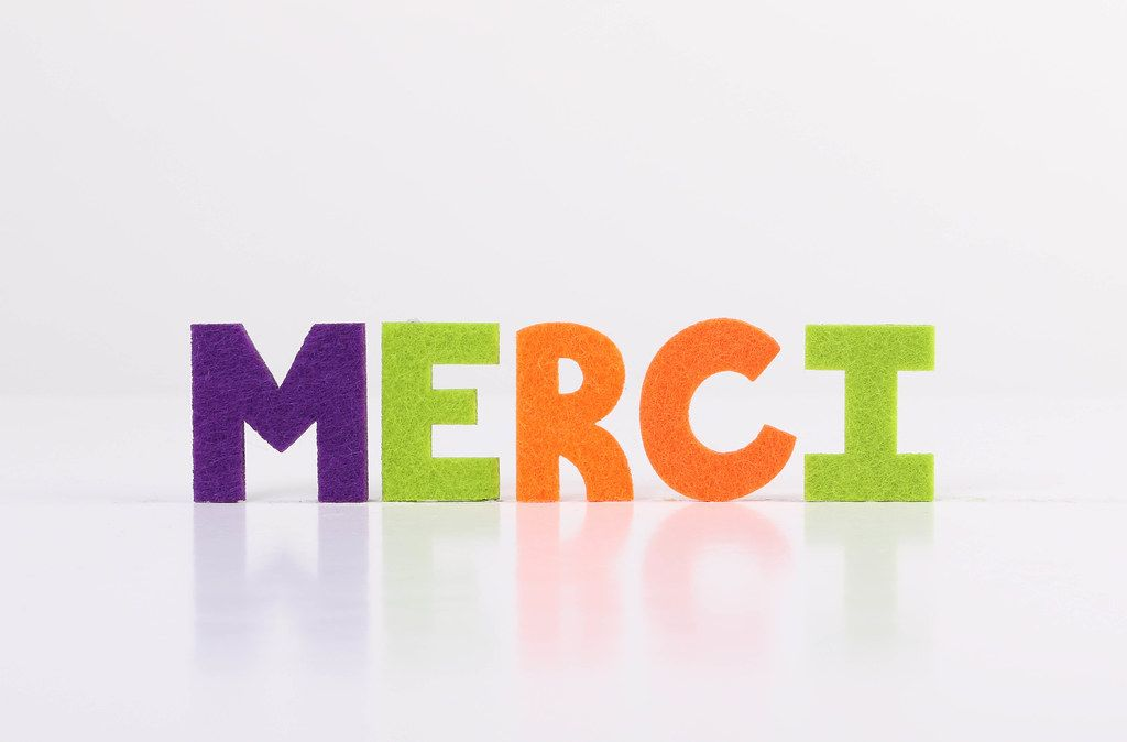 The word Merci on white background