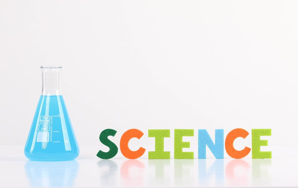 The word Science with laboratory flask on white background