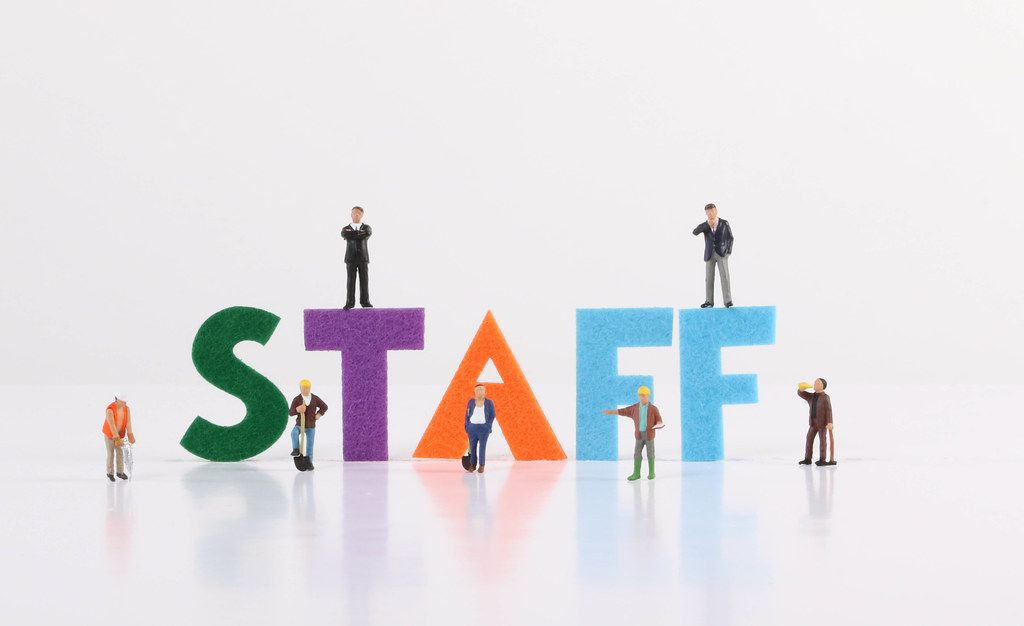 The word Staff with construction workers and two businessman on white background