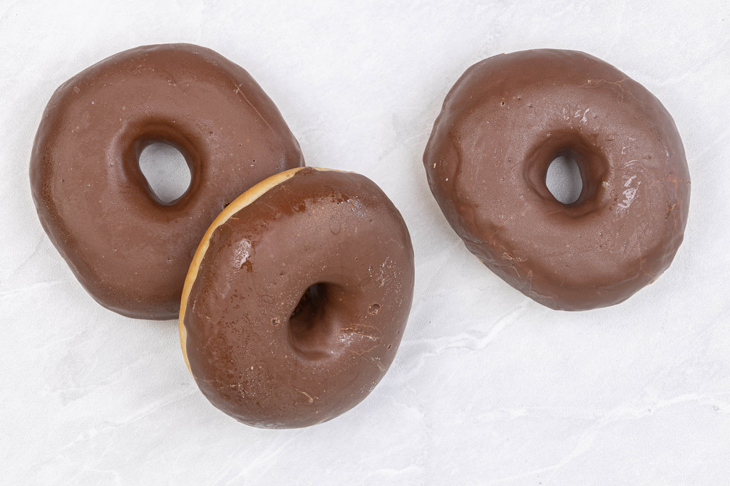 Three Chocolate Donuts on the table