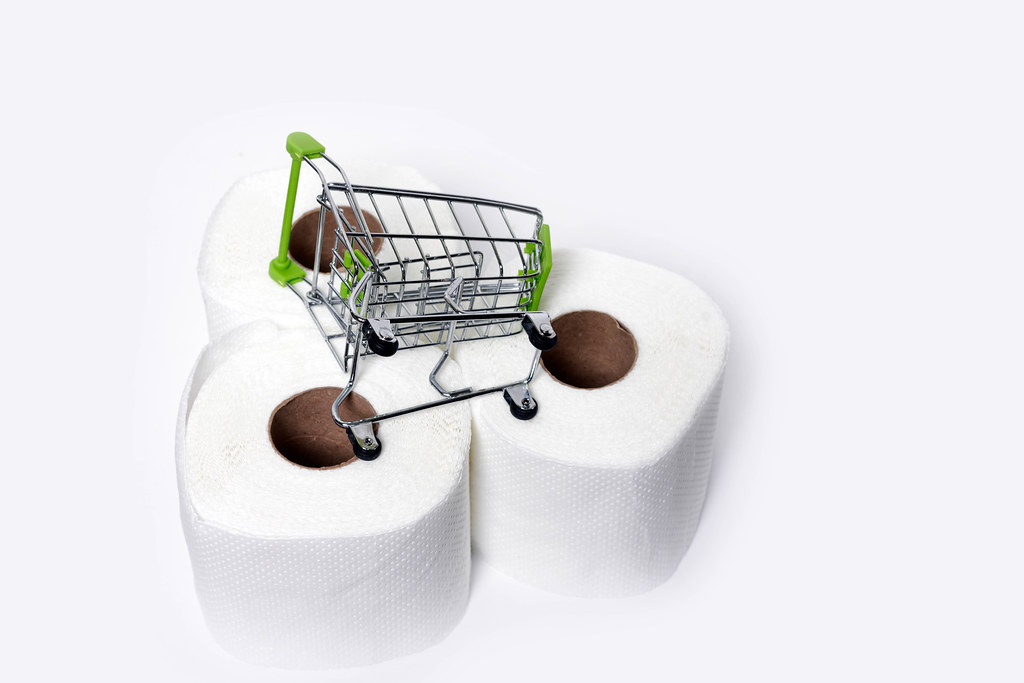 Three rolls of toilet paper and shopping trolley