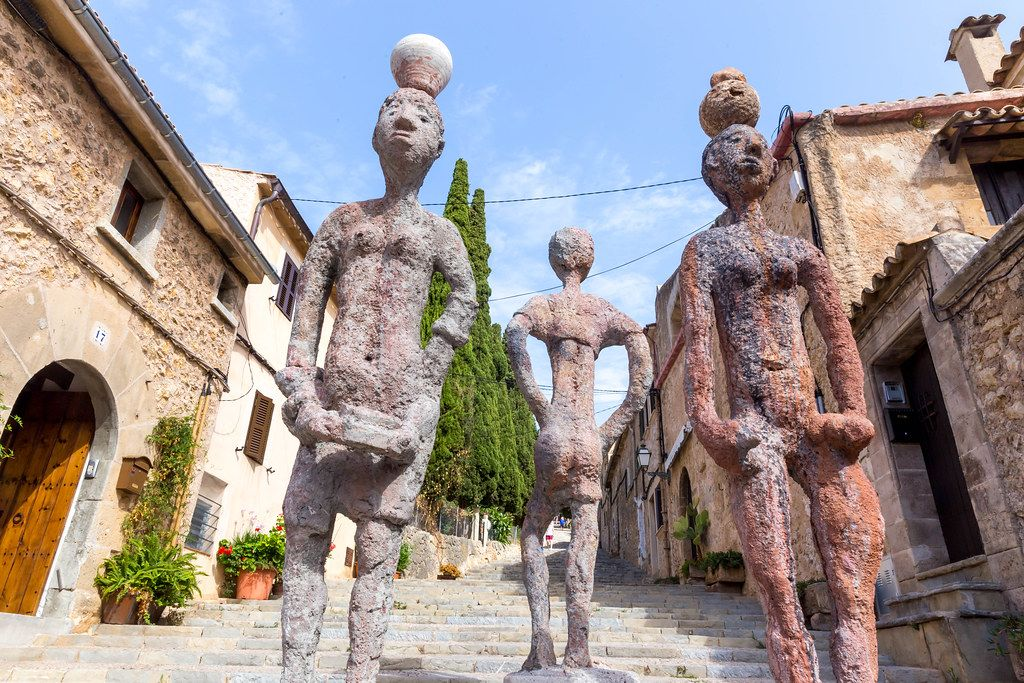 "Three sculptures of human figures on the 365 steps in Pollença. ""Raons Humanes"" by Joan Bennàssar"