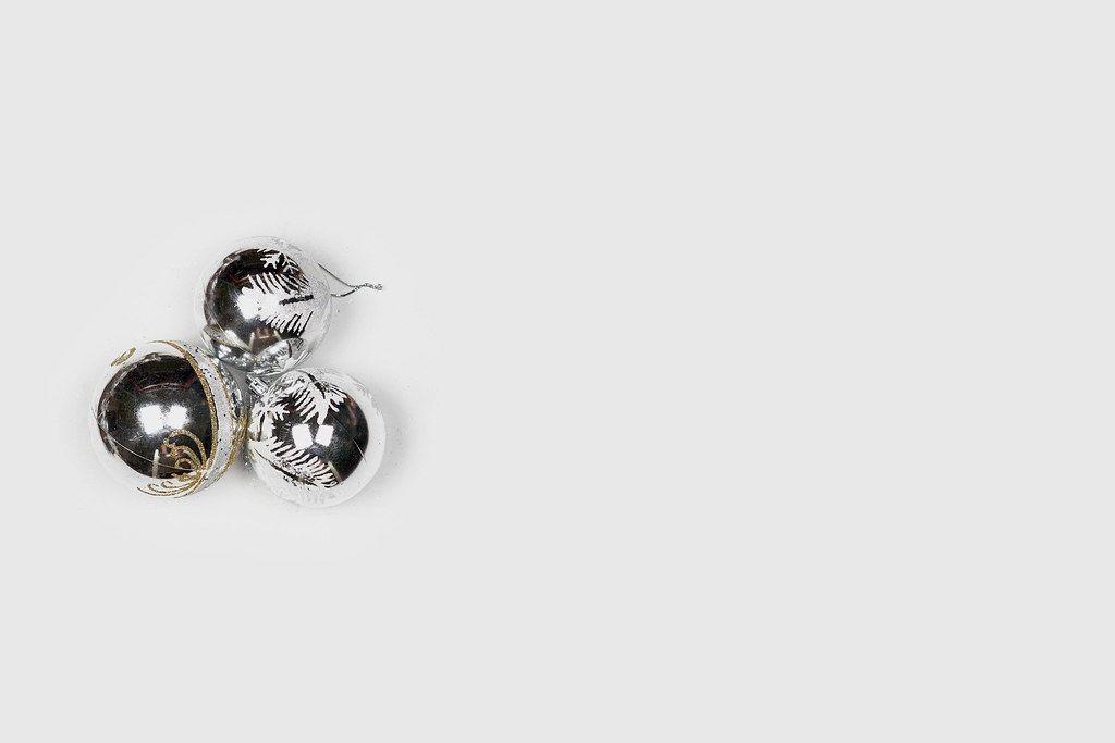 Three silver Christmas toys on the white background
