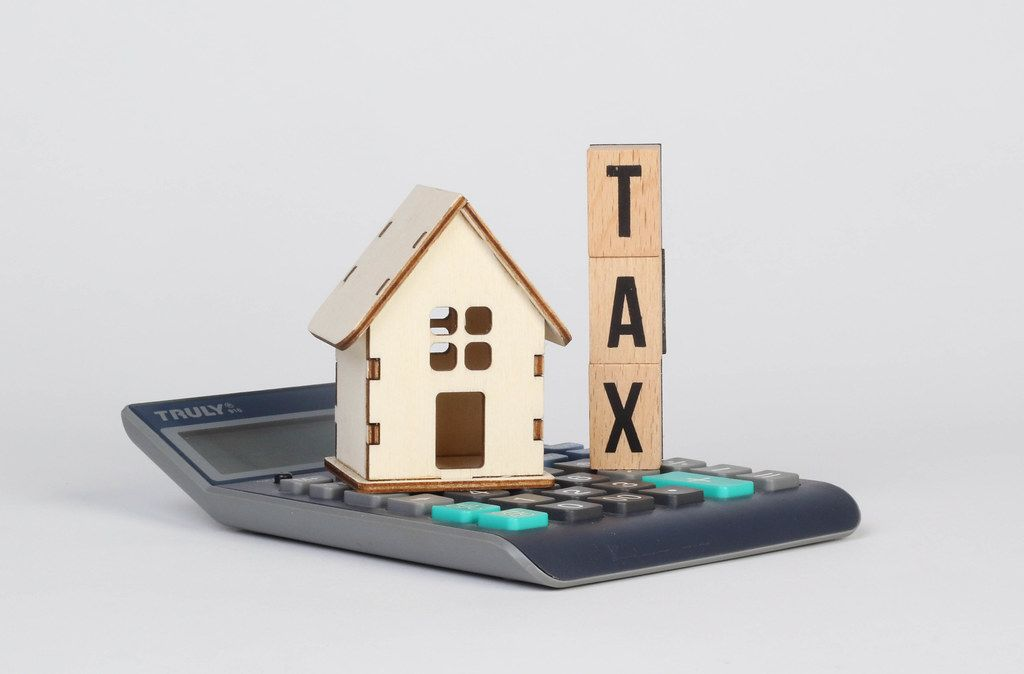 Tiny house and Tax text on calculator