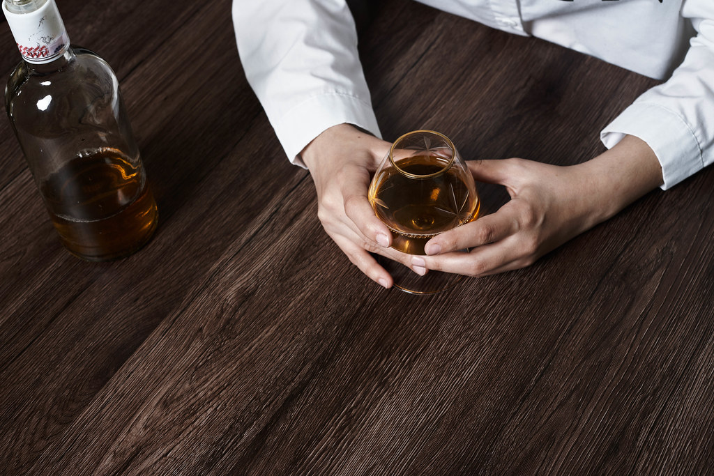 Tired of life problems person drinking whiskey