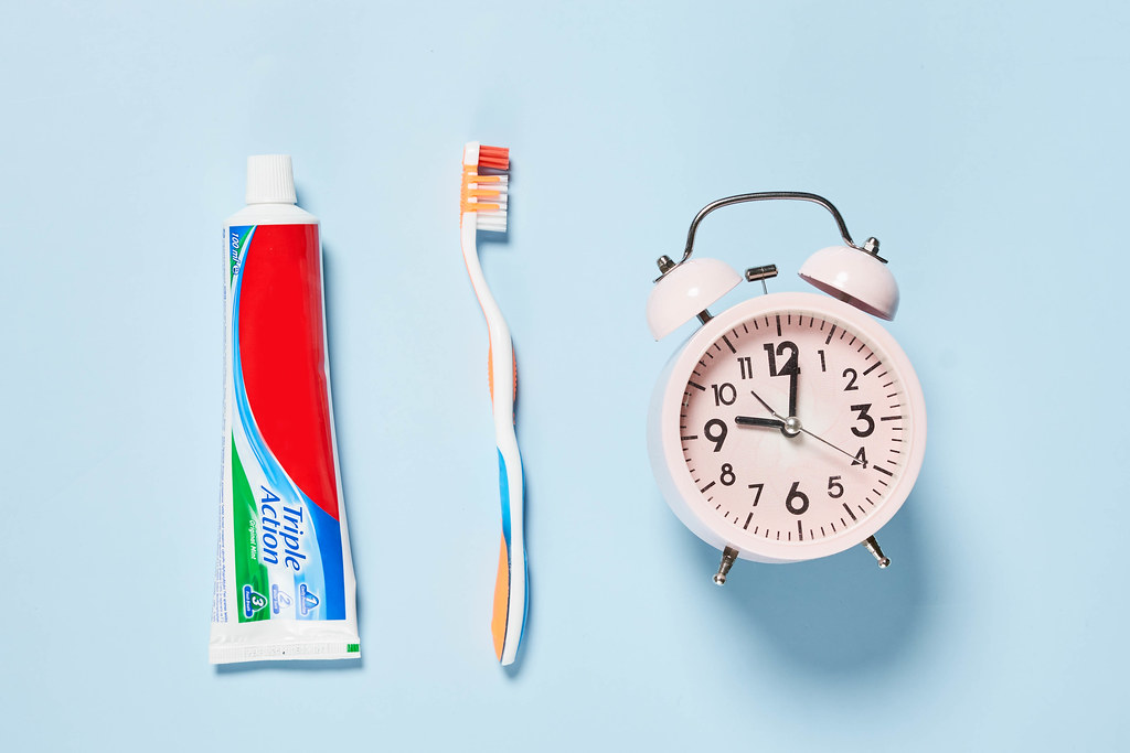 Toothpaste, toothbrush and alarm clock