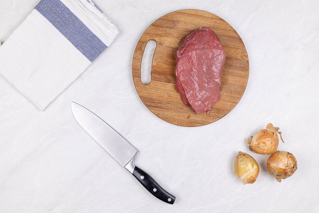 Top view Beef Meat slice on the wooden board with Onions