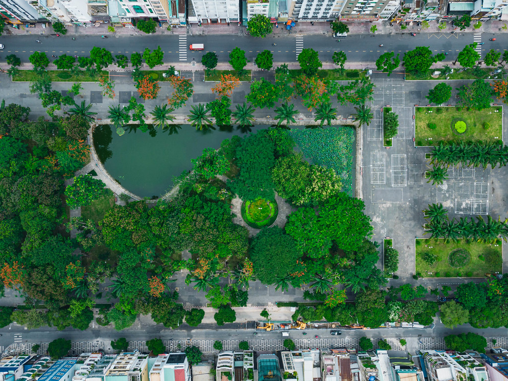 Top View Drone Photo of 23/9 City Park between Le Lai and Pham Ngu Lao Street with a small Lake and many Trees in Ho Chi Minh City, Vietnam