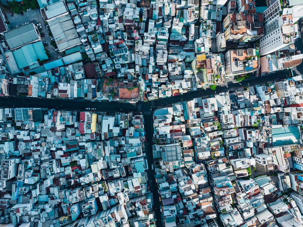 Top View Drone Photo of empty Bui Vien Walking Street in the Daytime with many Houses and small Alleys in Ho Chi Minh City, Vietnam