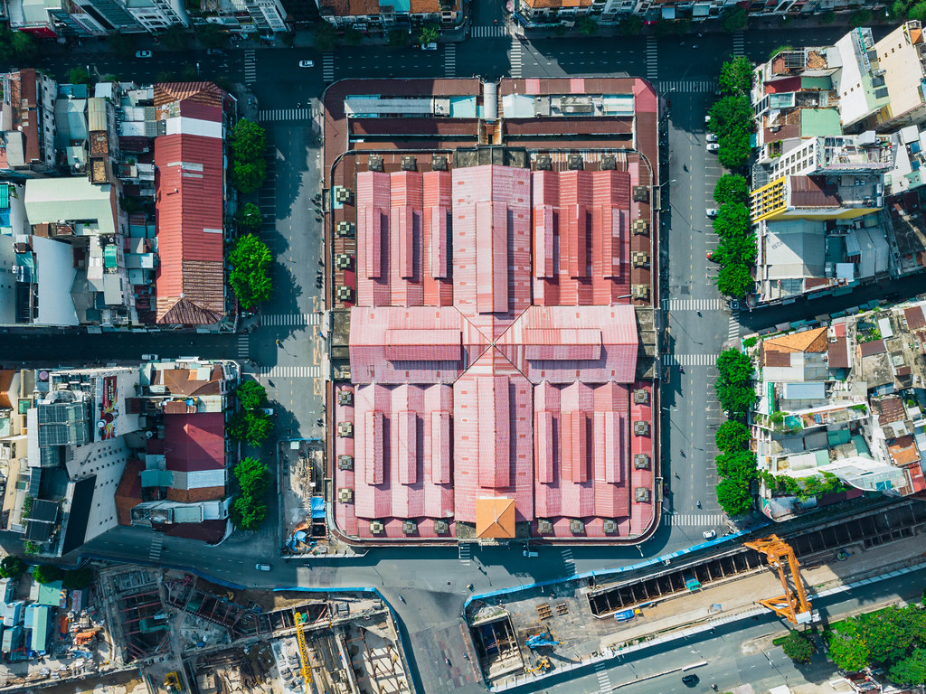 Top View Drone Photo of the famous Ben Thanh Market with empty Streets next to the Saigon Metro Construction in the City Center of Ho Chi Minh City, Vietnam