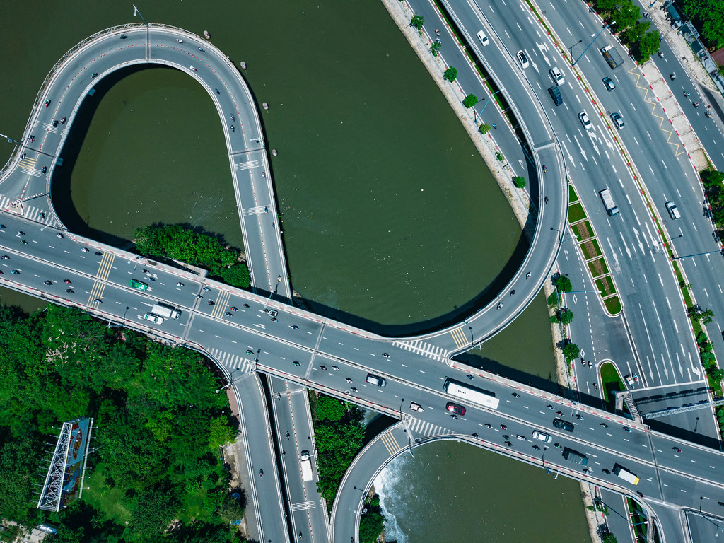 Top View Drone Photo of Traffic with Cars and Motorbikes on a Multi Level Bridge over Saigon River in Ho Chi Minh City, Vietnam