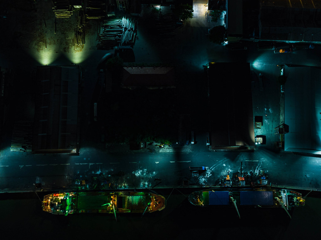 Top View Drone Photo of Transport Ships docked at the Khanh Hoi Nha Rong Port at Night in Saigon, Vietnam