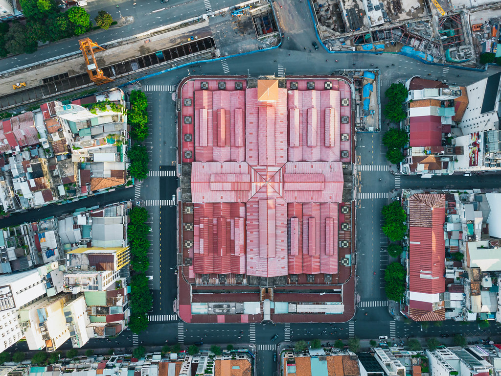 Top View Drone Shot of Tourist Attraction Ben Thanh Market next to the construction of Saigon Metro Central Station in Ho Chi Minh City, Vietnam