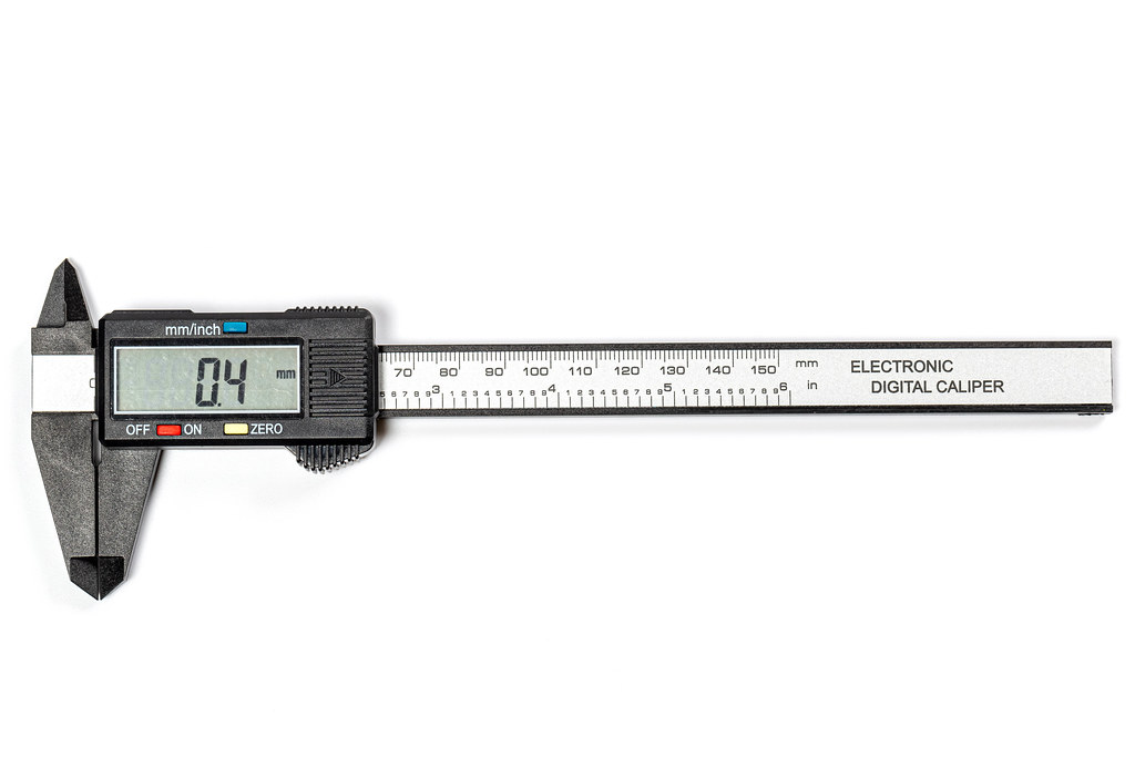 Top view, electronic vernier caliper on white