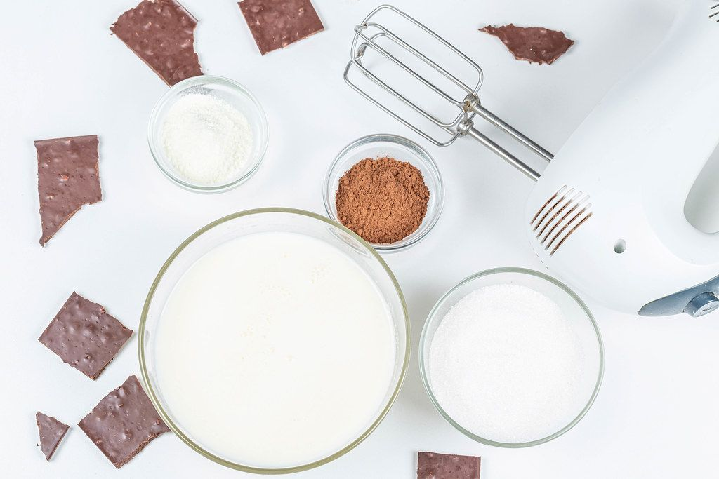Top view ingredients for making homemade chocolate ice cream