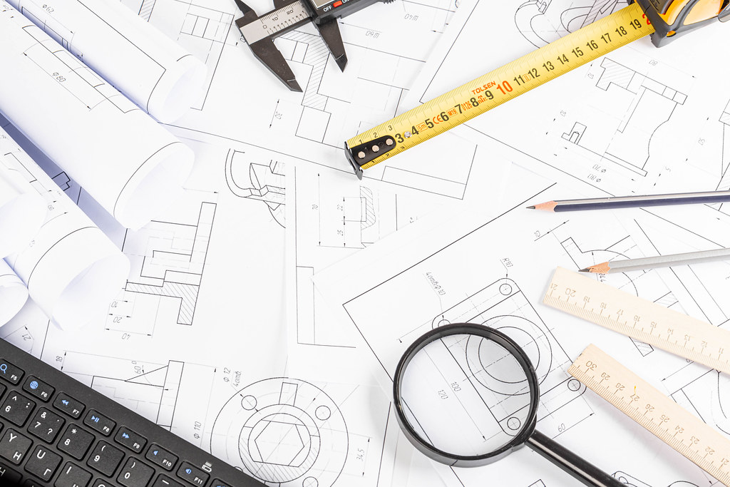 Top view, many blueprints and drawing tools, engineer workplace