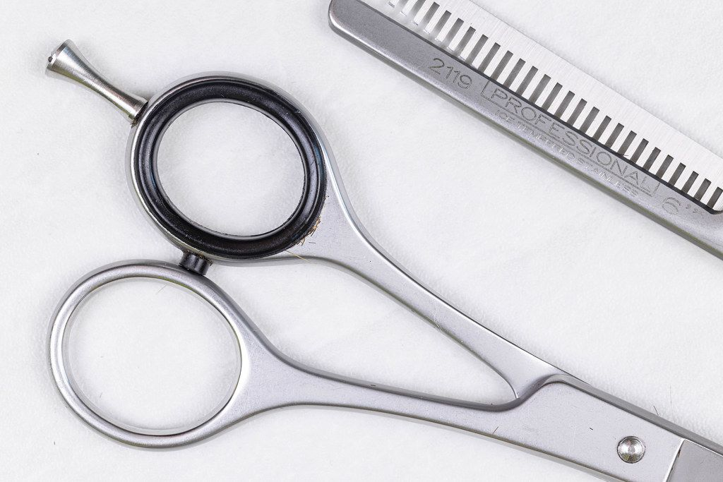 Top view Metal Haircut Scissors above white background