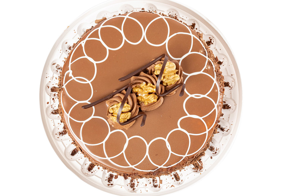Top view, milk chocolate cake with meringues and walnuts