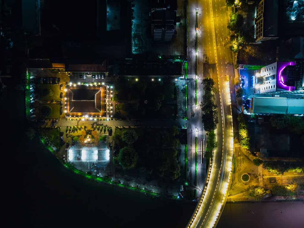 Top View Night Photo of the Ho Chi Minh Museum next to Khanh Hoi Bridge at Saigon River in District 4 in Ho Chi Minh City, Vietnam