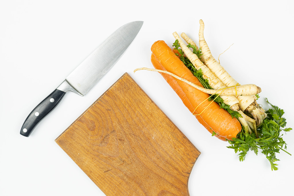 Top view of Carrot and Parsnip on the table with knife