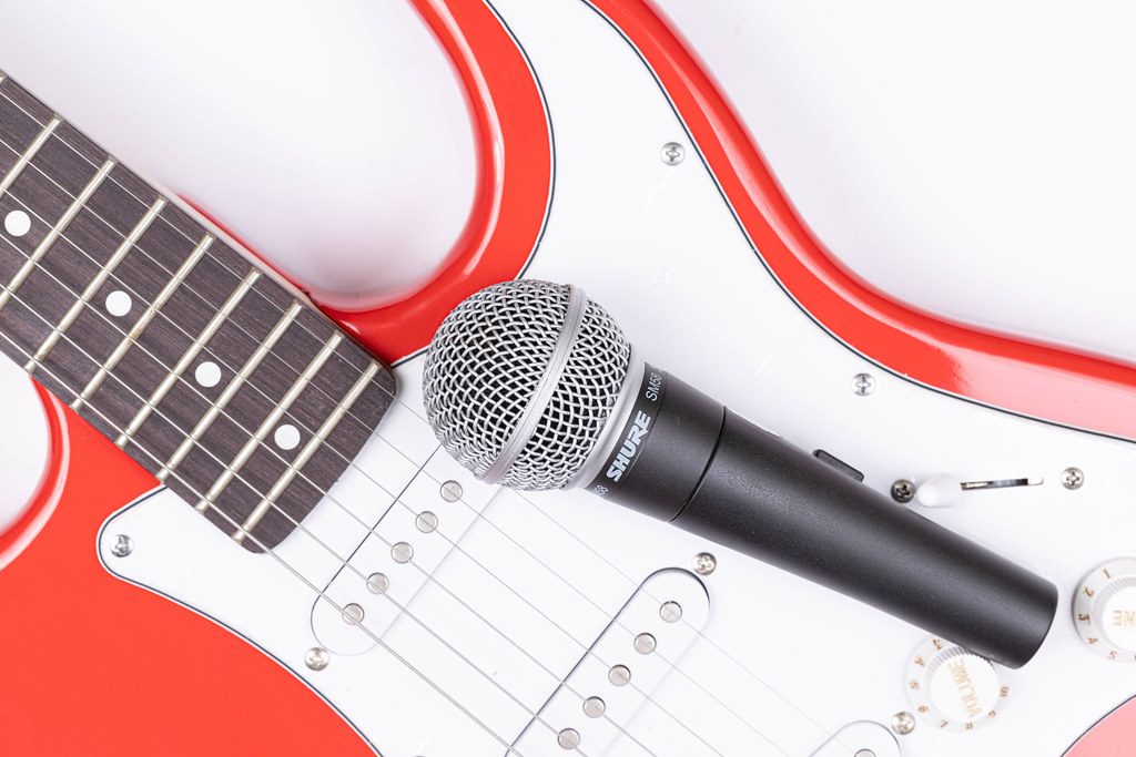 Top view of Electric Guitar and Shure Microphone