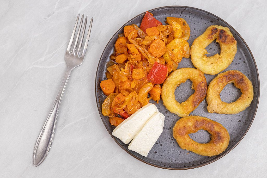 Top view of Fried Fish Rings with cheese and Vegetables