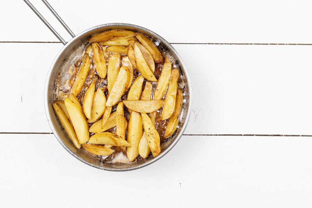 Top view of Frying Potatoes in the frying pan